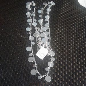 Boxed Silvertone disc necklace